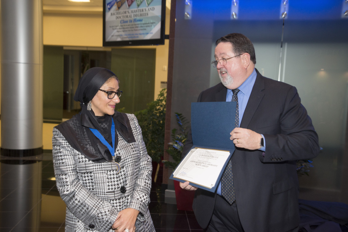 Collin College Professor Dr El-Ashmawy receiving award